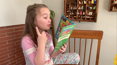First grader reading a new book